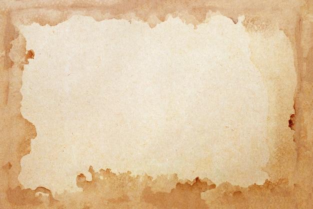 Alte braune papierschmutzwand. abstrakte flüssige kaffeefarbtextur.