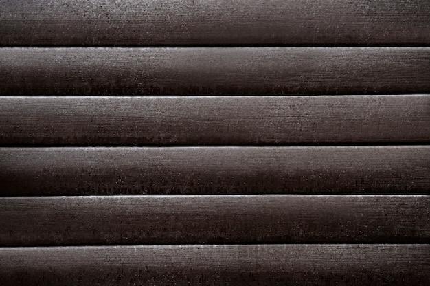 Alte dunkelbraune metallische wandbeschaffenheit