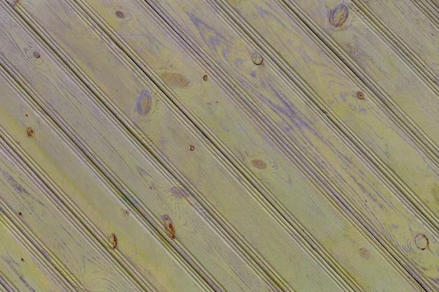 Alte gelbe bretter diagonale beschaffenheit alten holzhintergrund