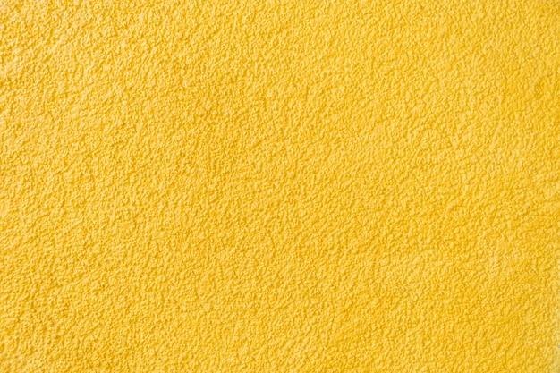 Alte gelbe steinmauer hintergrundtextur sandstein