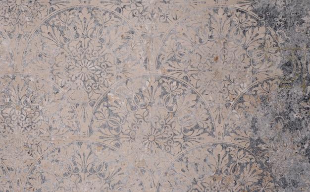 Alte graue vintage schäbige patchworkfliesen steinbeton zementwand textur hintergrund