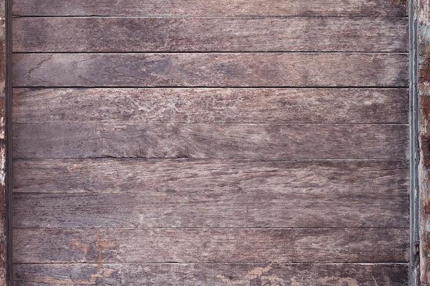 Alte hölzerne beschaffenheitstischplatte benutzen sie uns hintergrunddesign für weinlesehintergrund