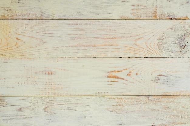 Alte hölzerne weiße plankenbeschaffenheit des natürlichen gemalten schreibtischhintergrundes.