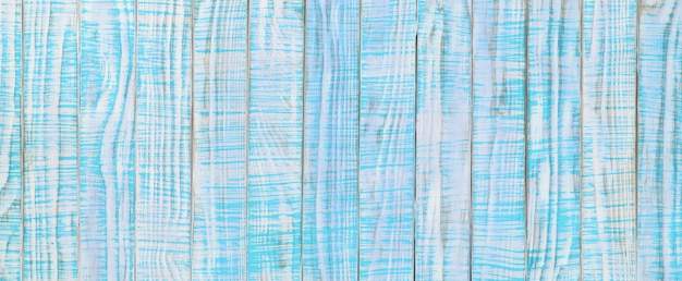 Alte holzstruktur in blaugrüner oder türkisfarbener farbe. hellblauer holztisch, draufsicht