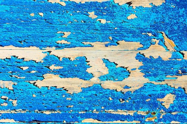 Alte holzstruktur mit abblätternder blauer farbe, kann als hintergrund verwendet werden