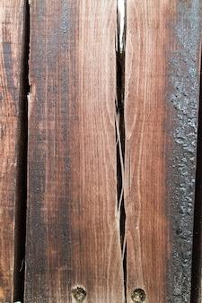 Alte holzstruktur mit löchern und rissen