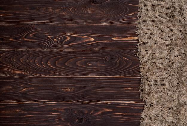 Alte leinwand fabricon braune holzoberfläche