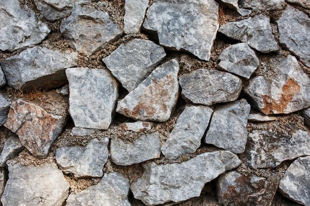 Alte mauer aus grauen steinen