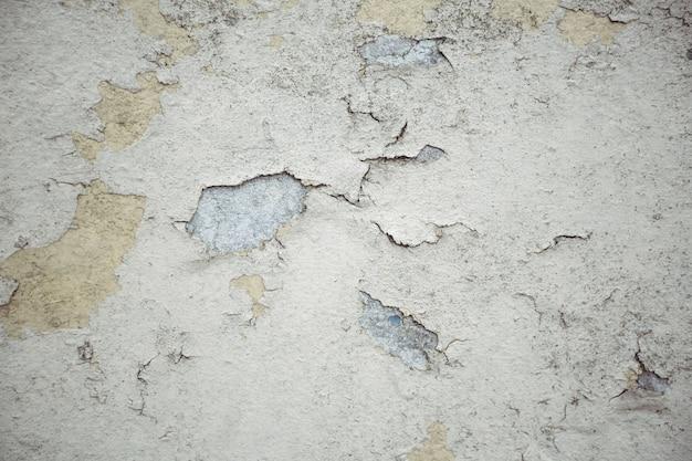 Alte mauer mit geschälten gips hintergrund