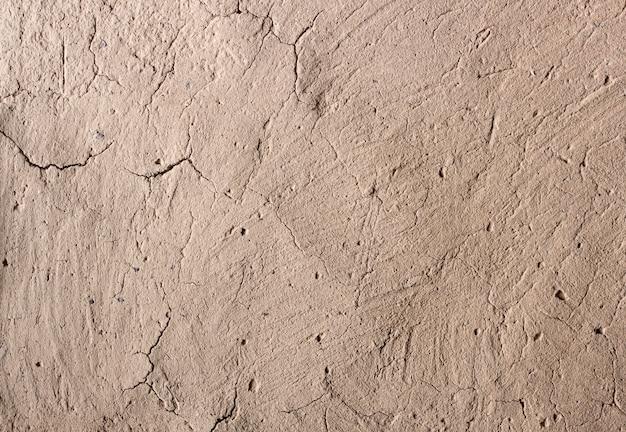 Alte mauer mit rissiger oberfläche