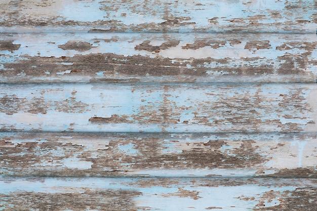 Alte raue holzstücke texturieren oberflächenhintergrund und hellblaue farbabriebe von natur aus