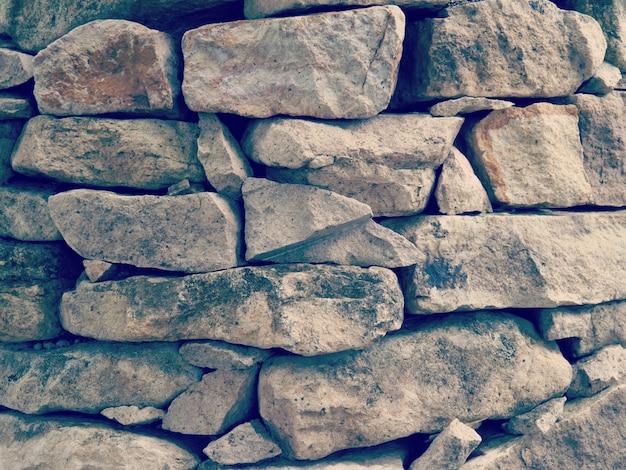 Alte retro- weinleseart der steinwand