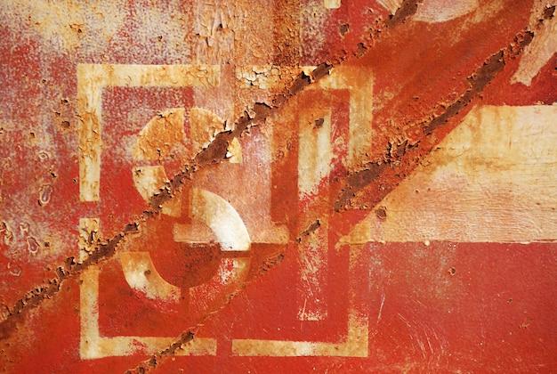 Alte rostige gemalte metallwand mit zahlen