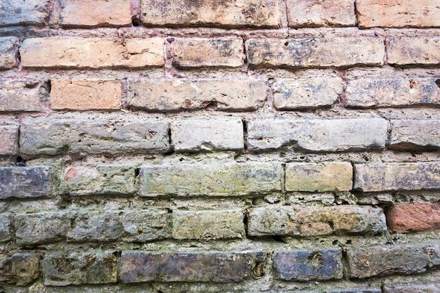Alte rote backsteinmauerbeschaffenheit