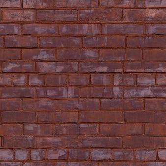 Alte rote gemalte backsteinmauer mit schönen reihen der befleckten ziegelsteine. nahtloses muster.