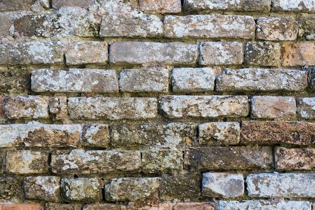 Alte schmutzige backsteinmauerbeschaffenheit