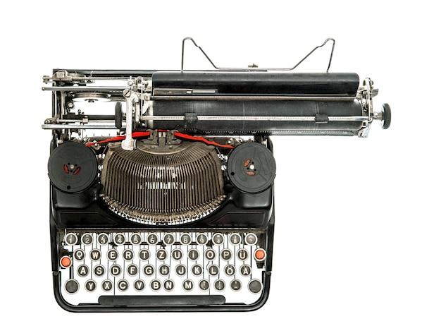 Alte schreibmaschine isoliert auf weißem hintergrund. antikes objekt. ansicht von oben