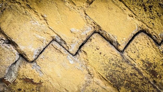 Alte steinmauer mit einem riss. textur für design