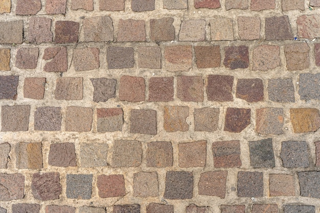 Alte straße mit granitsteinen gepflastert
