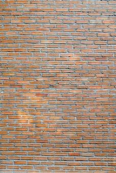Alte und rohe backsteinmauer auf hintergrund oder beschaffenheit.