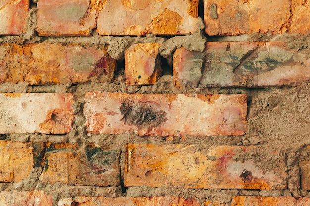 Alte verwitterte braune backsteinmauer für hintergrund