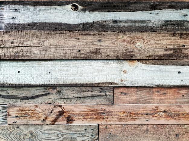 Alte verwitterte holzfässer, bretter oder zaun mit strukturiertem hintergrund