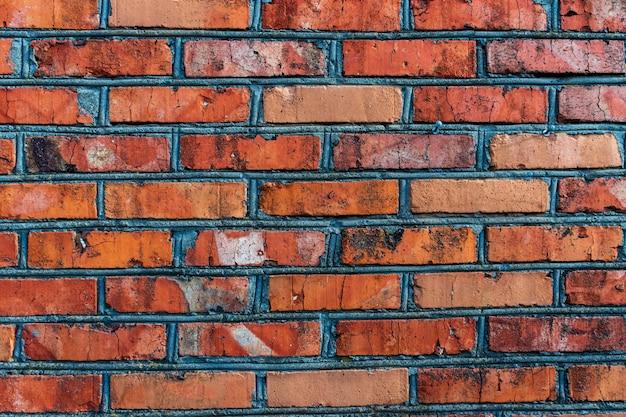 Alte verwitterte rote backsteinmauer für textur oder hintergrund, klassisches raues mauerwerk, vintage-mauerwerk mit zementmörtel