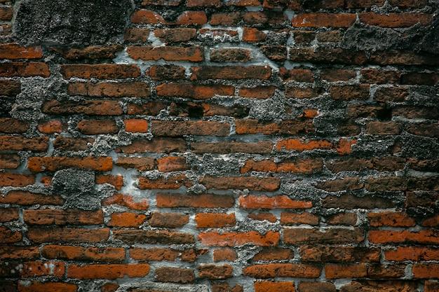 Alte wandreparatur des roten backsteins der weinlese durch zement, sprungsbacksteinmauerbeschaffenheitshintergrund
