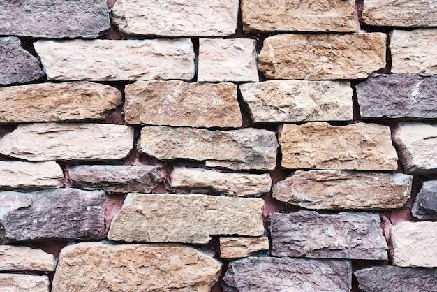Alte wandsteinbeschaffenheit. abstrakter hintergrund mit ziegelsteine