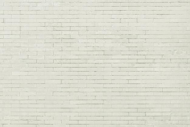 Alte weiße backsteinmauerhintergrundbeschaffenheit
