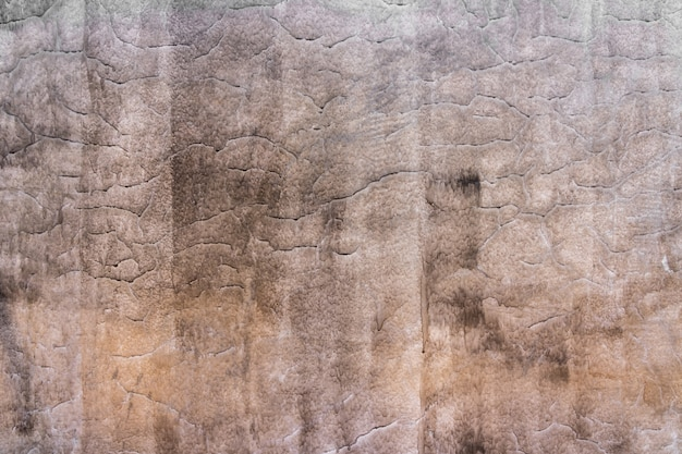 Alte zement- oder betonmauerbeschaffenheit und -hintergrund. polierte putzwände.