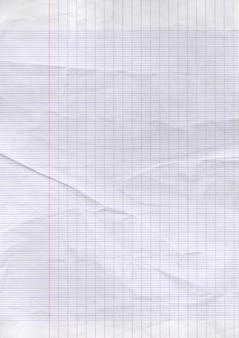 Alter abgenutzter linierter papierblatttexturhintergrund.