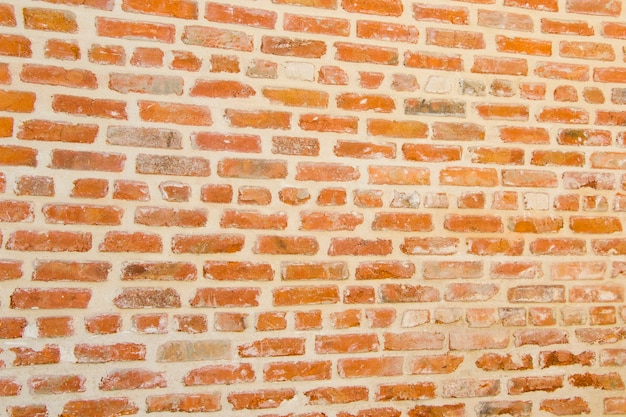Alter backsteinmauerhintergrund und -beschaffenheit, tageslicht und im freien