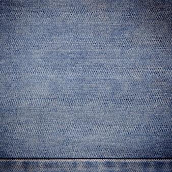Alter blauer jeanshintergrund und beschaffenheit nah oben