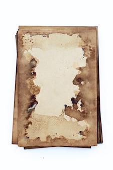 Alter brauner papierschmutzhintergrund. abstrakte flüssige kaffeefarbbeschaffenheit.
