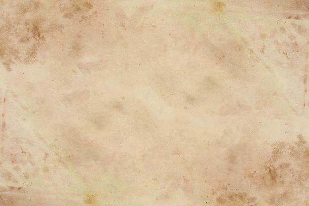 Alter brauner papierschmutzhintergrund. abstrakte flüssige kaffeefarbtextur.