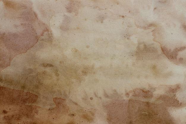 Alter brauner papierschmutzhintergrund.