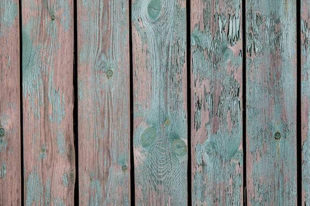 Alter gemalter hintergrund abschluss der hölzernen planken-rauen beschaffenheit oben. verblaßte und grüne farbe auf dem bretterzaun abziehend