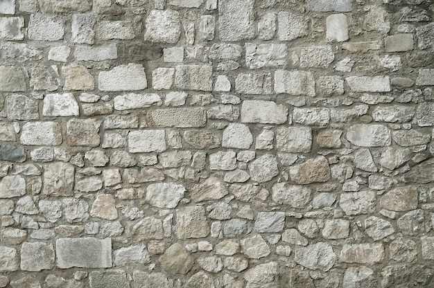 Alter granitsteinwand-beschaffenheitshintergrund