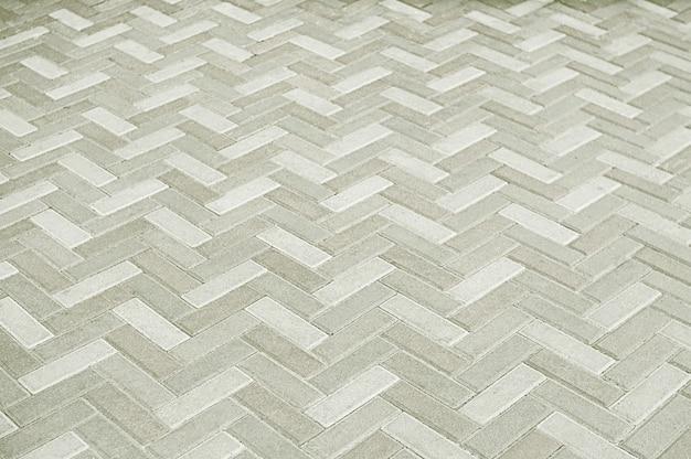 Alter grauer mosaikpflasterungs-beschaffenheitshintergrund