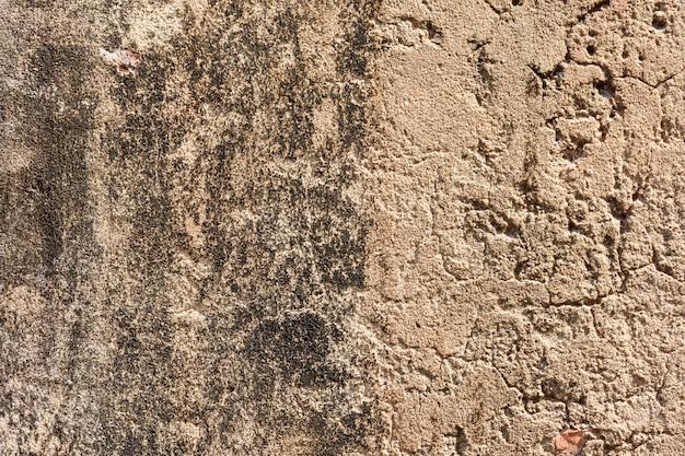 Alter grauer zement oder betonmauer. schmutz vergipster strukturierter hintergrund des stucks.