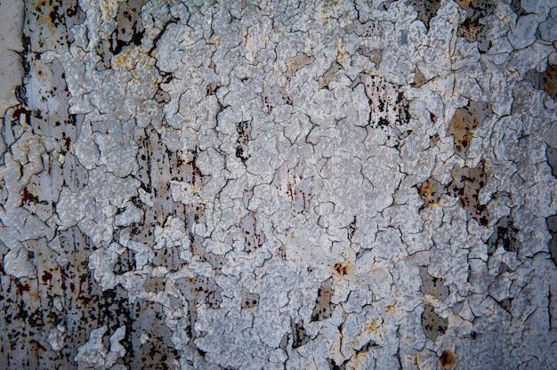 Alter grunge beschaffenheitshintergrund der gebrochenen farbe. makrofoto für oberfläche