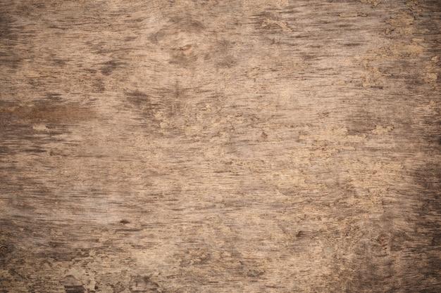 Alter grunge dunkler strukturierter hölzerner hintergrund. die oberfläche der alten braunen hölzernen beschaffenheit