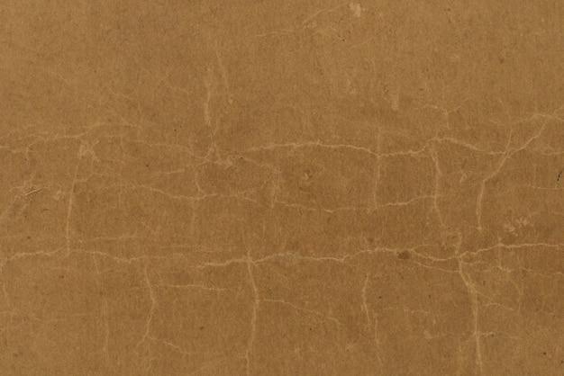 Alter handwerkspapierhintergrund und gemasert