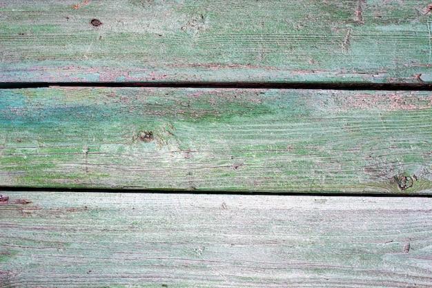 Alter hintergrund des hölzernen brettes mit gebrochener farbe