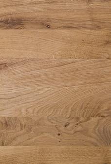 Alter hölzerner gelber oder brauner texturhintergrund. vertikales bild von brettern oder paneelen