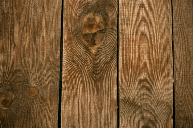 Alter holzbodenhintergrund. holzzaun, schreibtischoberfläche. natürliche farbe, grunge board, brauner verwitterter tisch.