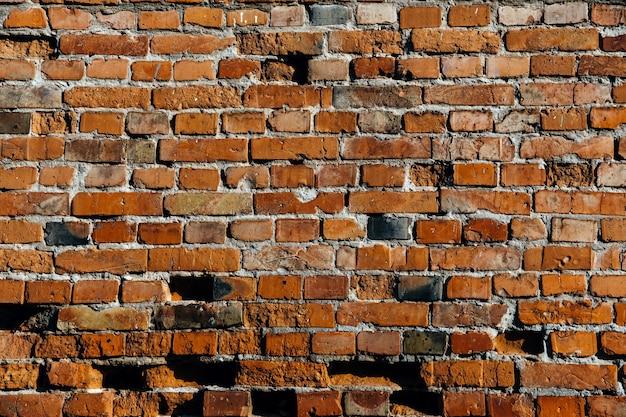 Alter rötlicher backsteinmauerhintergrund