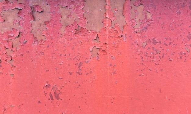 Alter rostiger gemalter metallhintergrund. rote schalenfarbenbeschaffenheit.