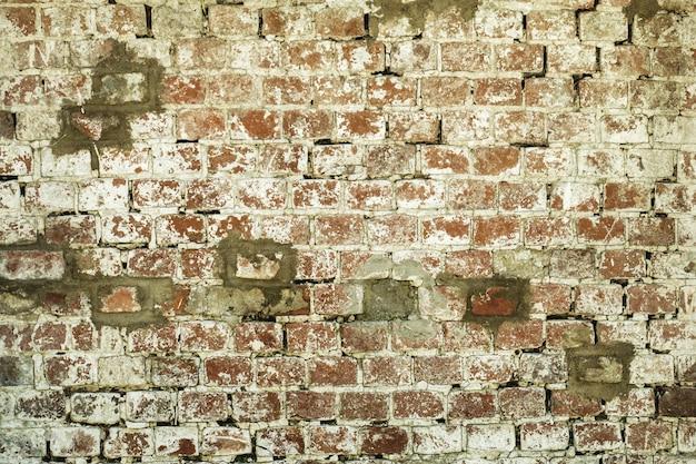 Alter roter und weißer wandbeschaffenheitshintergrund des ziegelsteines